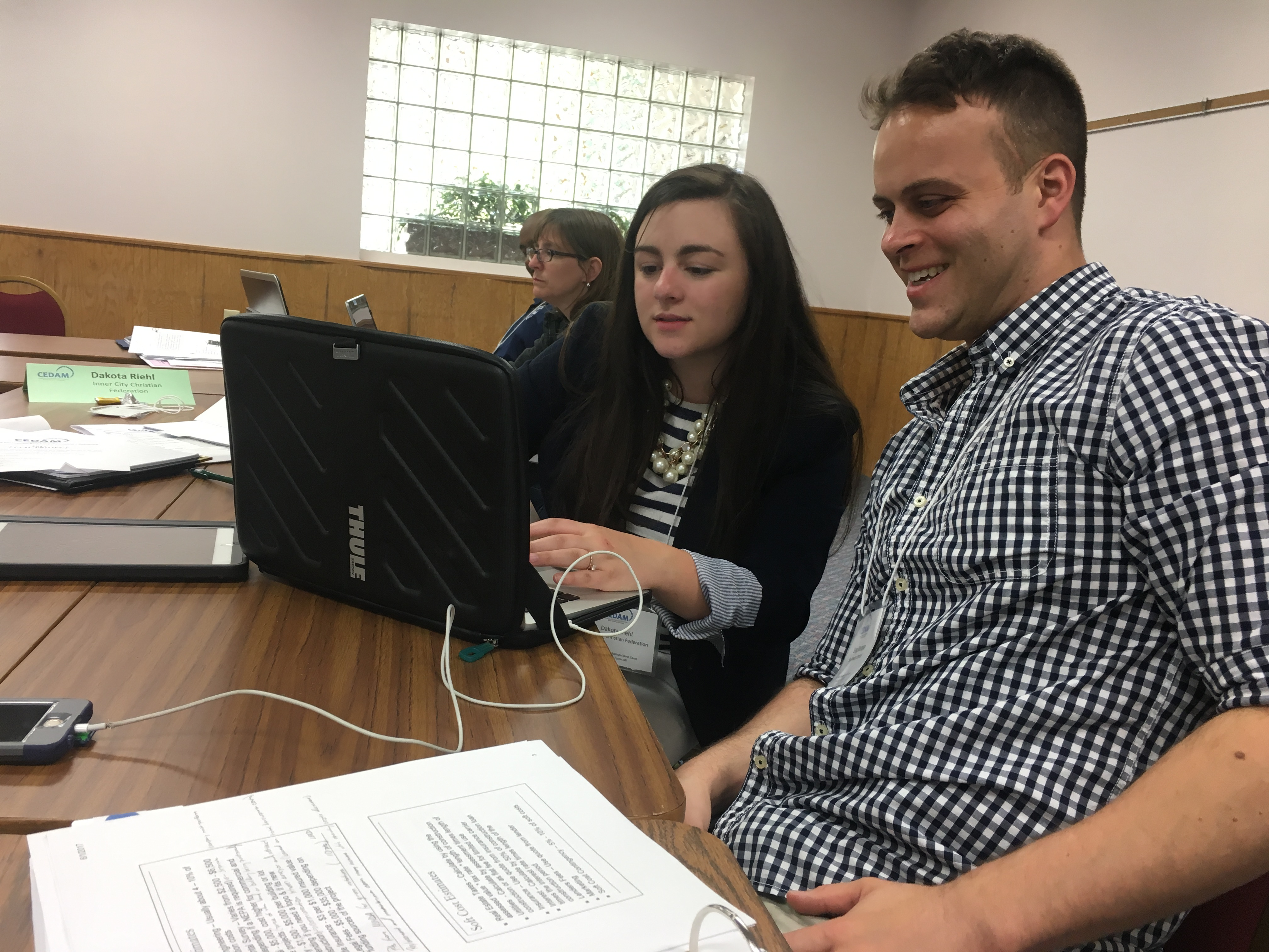 Dakota Riehl (Inner City Christian Federation) and group member Greg Mangan (Southwest Detroit) work together on their final project.