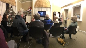 """Community members and Rural Opportunity VISTA members discuss civil rights and the film """"Detroit"""" in the Mason County District Library."""